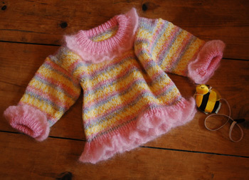 A little girls hand knit sweater pattern available soon