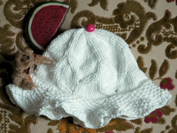 Emily Knitted Hat for a Baby Girl Side View
