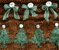 Detail shot from one of fireflys hand knit Christmas Stocking designs